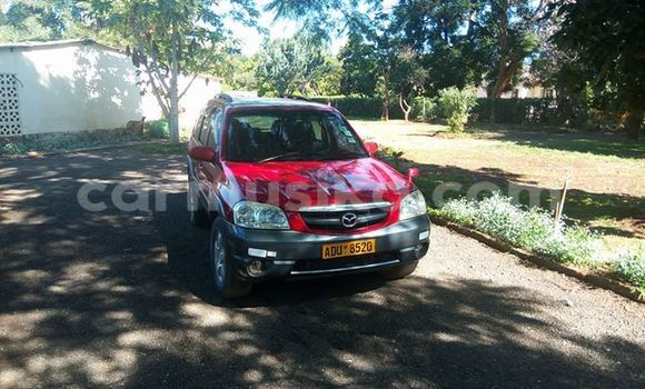 Buy Used Mazda Tribute Red Car in Alexandra Park in Harare