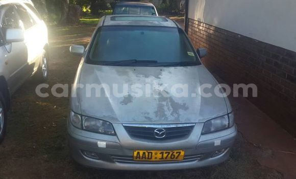Buy Used Mazda 626 Silver Car in Alexandra Park in Harare