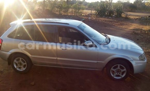 Buy Used Mazda Familia Silver Car in Alexandra Park in Harare