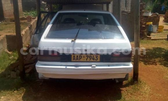 Buy Used Mazda 323 White Car in Alexandra Park in Harare